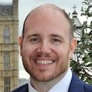 Dr Justin  Varney